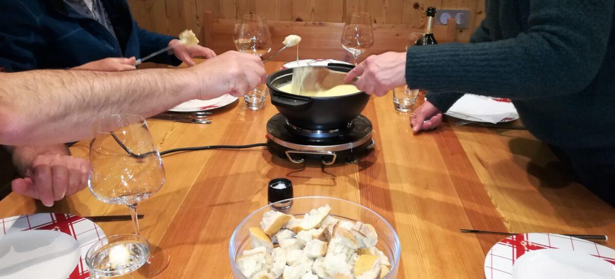 Guests around a Savoyard fondue