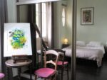 Paintings, mirror, bed, table, chairs, windows
