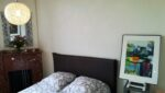 Un lit, un tableau