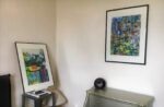 Two paintings, a dresser