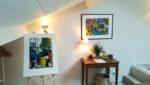 Paintings, table, old clock radio