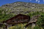 A chalet of stone and wood, a mountain