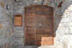 An old wooden door, a mailbox