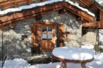 A typical Savoyard chalet, a wooden table under the snow