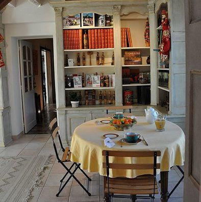 Table with breakfast in a library