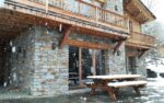 A chalet, falling snow