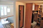 A dressing room, a bedroom, a window