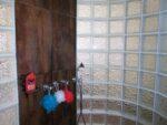 Shower, glass tiles, soap, sponges